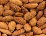 a photo of a pile of almonds a natural source of tyrosine