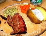 a photo of dinner plate of beef, carrots, and baked potato all natural sources of Vitamin B6 Pyridoxine