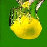 photo for guide book a lemon falling through a stream of water