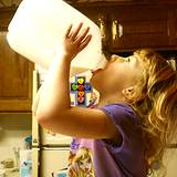 photo of a little girl drinking milk out of a gallon jug a natural source of Lysine