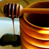a photo of a crock of molasses with molasses dripping from dipper a natural source of PABA