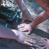 photo of children playing in the dirt in danger of needing a parasite cleanse