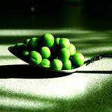 photo of a spoonful of peas a natural source of vitamin C