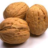 photo of three walnuts a natural  source of valine
